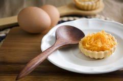 Golden sweet tart on white plate Stock Photos