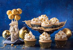 Golden sweets for christmas. On a blue background royalty free stock photography