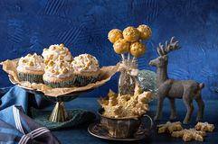 Golden sweets for christmas. On a blue background royalty free stock image