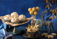 Golden sweets for christmas. On a blue background royalty free stock images