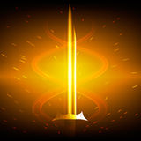 Golden sword. Flaming golden sword in a fountain of sparks Stock Image