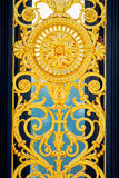 Golden Symbol. Detail of golden fence of Versailles Palace. France Stock Photo