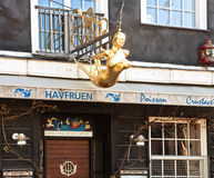 Golden syren insignia on the door of a fisf restaurant at Nyhavn Stock Image