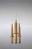 Golden syringes Royalty Free Stock Photography