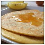 Golden syrup pancakes Royalty Free Stock Images