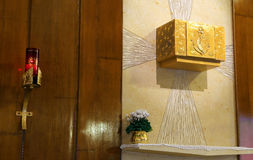 Golden Tabernacle and lighted candle in the Church Royalty Free Stock Image