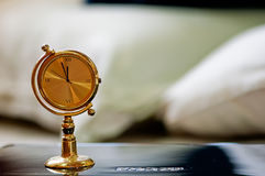 A golden table clock Stock Images