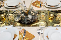 Golden table setting Stock Images