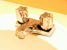 Golden Taps. Bathroom taps royalty free stock image