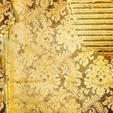 Golden tattered background. Vintage golden tattered background with patterns Stock Image