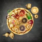 Golden tea decoration Arabic traditional dishes. Golden tea table decoration. Arabic traditional dishes Royalty Free Stock Photos