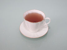 Golden tea in a porcelain Cup Stock Photography