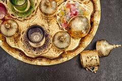 Golden tea table decoration Arabic traditional delight. Golden tea table decoration. Arabic traditional delight. Ramadan kareem Royalty Free Stock Image