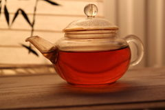 Golden tea in a teapot. Golden tea in an elegant teapot Royalty Free Stock Photo