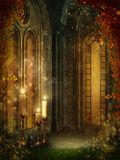 Golden temple 1. Fantasy room with golden windows, candles and colorful vines Stock Photo