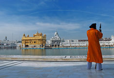 Golden Temple in Amritsar, India. The Sikh guard with the Golden Temple in the background Royalty Free Stock Image
