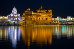 The Golden Temple at Amritsar, Punjab, India, the most sacred icon and worship place of Sikh religion. Illuminated in the night, r Royalty Free Stock Photo