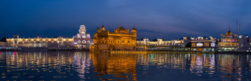 The Golden Temple at Amritsar, Punjab, India, the most sacred icon and worship place of Sikh religion. Illuminated in the night, r