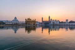 The Golden Temple at Amritsar, Punjab, India, the most sacred icon and worship place of Sikh religion. Sunset light reflected on l. Ake Royalty Free Stock Images