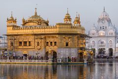 The Golden Temple at Amritsar, Punjab, India, the most sacred icon and worship place of Sikh religion. Sunset light reflected on l. Ake Royalty Free Stock Image