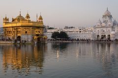 The Golden Temple at Amritsar, Punjab, India, the most sacred icon and worship place of Sikh religion. Sunset light reflected on l Stock Photo