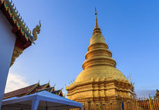 Golden temple and blue sky. Golden temple and beautiful blue sky live in Lumphun,Thailand Stock Images