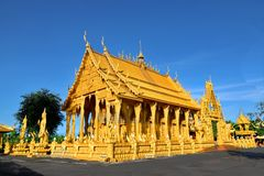 A golden temple in the central region of Thailand. A temple in the central region of Thailand was painted in gold color. Very unique and outstanding. May be the stock image