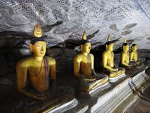 The golden temple of Dambulla is world heritage site and has a total of a total of 153 Buddha statues, three statues of Sri Lankan stock photo