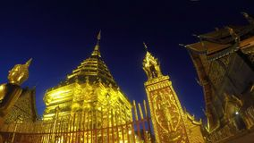 Golden temple at dusk. Gold pagoda temple timelapse from day to night in Chiang Mai Thailand stock footage