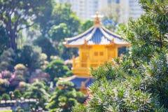 Golden temple in a garden Stock Photography