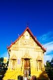 Golden temple landmark of Wat Pra Sri Arn against blue sky in Ph Stock Photo