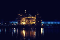 Golden temple at night Stock Images