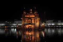 Golden Temple At Night. The Harmandir Sahib (The Golden Temple) is the holiest shrine in Sikhism. It is located in the city of Amritsar - India Royalty Free Stock Images