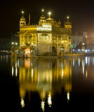 Golden Temple by night, India. View to  Golden Temple and Holy Lake at night, Punjab, India Royalty Free Stock Images