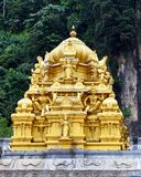 Golden temple roof. The golden roof of a Hindu temple, part of the Batu Caves complex near Kuala Lumpur, Malaysia. TBatu Caves is a world renowned tourist royalty free stock photo