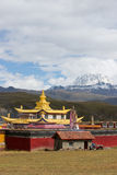 Golden temple with snow mountain Royalty Free Stock Image