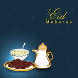 Golden text Eid Mubarak with sweets for festiva Royalty Free Stock Image