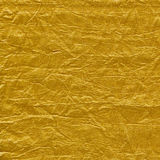 Golden texture. Background taken from gold cloth Stock Images
