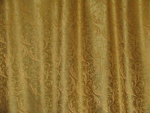 Golden texture of fabric with the waves Stock Images