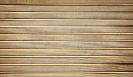 Golden texture with horizontal stripes Royalty Free Stock Photos