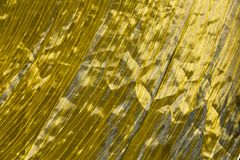 Golden texture of silk. Texture of the golden colour silk Stock Image