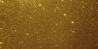 Golden glitter textured background. royalty free stock photos