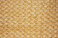 Golden textured oilcloth or leather Stock Photos