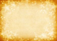 Golden textured star background. Stock Photo