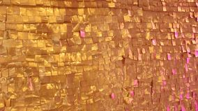 Golden textured wall stock video footage