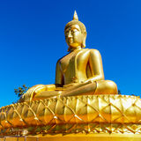 Golden thai Buddha in the style of Theravada tradition meditatin Stock Photography