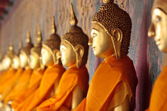Golden Thai Buddhas in Orange Royalty Free Stock Images