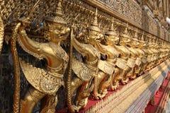 Golden Thai garuda. Line of golden Thai garuda statue Royalty Free Stock Photos