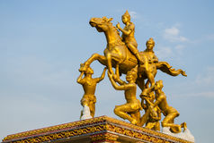 Golden thai god sculpture. On blue sky Royalty Free Stock Photo