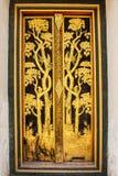 Golden thai Pattern art on door Royalty Free Stock Photos